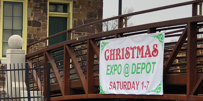 christmas expo banner posted on the side of a bridge